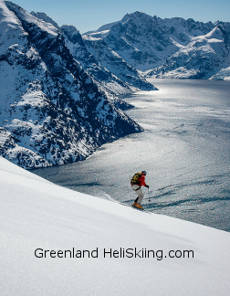 greenland heli-skiing - skiing in powder down to the fjord