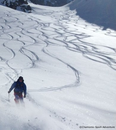 heli-skiing in deep powder in the grand paradisco national park, aosta