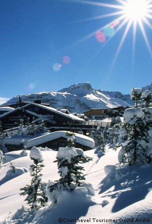 ski chalet holiday in courchevel covered in snow