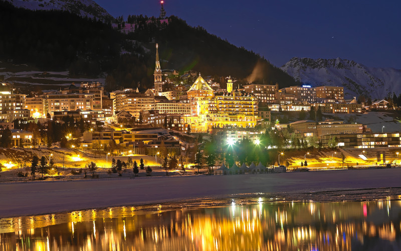st-moritz ski resort, engadine at night over looking the lake